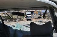 Bent Jbail, Lebanon. An ICRC convoy advances through bomb debris.