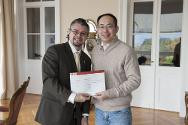 One of the training course's 32 participants, Professor Wei (right) from China University of Political Science and Law, receives his course attendance diploma from Etienne Kuster, ICRC academic relations adviser.