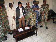 ICRC delegate and Sudanese officer signing hand-over documents for the repatriation of PoWs