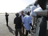South Sudanese prisoners of war boarding the ICRC plane in Nyala, Sudan for their journey to Juba, South Sudan.