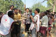 Villagers helping the ICRC repair a hand pump in Bijpur district. The ICRC encourages community members to become involved in repair work and to take responsibility for maintenance.