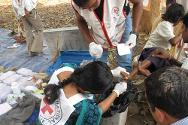 An ICRC nurse working in the makeshift pharmacy of the mobile health unit in Bijapur district.
