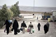 Families from Baghdad leave Chamchamal Prison after visiting their relatives.