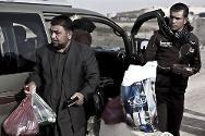 Raâd M'hissen arrives at Chamchamal Prison to finally meet his nephew after eight years of separation. The plastic bags contain the food he will share with him during the visit.