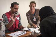 Mafraq Governorate. The ICRC and the Jordan Red Crescent Society distribute debit cards to vulnerable Syrian families living in host communities.