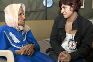 ICRC staff member talking to a woman whose relative is missing