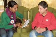 Beirut. An ICRC delegate hands Mohammad his travel document. As a minor, Mohammed was able to travel from Lebanon to Jordan with a one-way travel document that was issued by the ICRC.