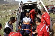 Lebanese Red Cross personnel move a wounded Syrian refugee into an ambulance in the Shebaa region, Lebanon.