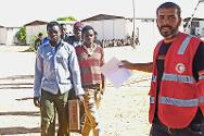 Migrants queue to contact their families. With the help of LRCS volunteers, the ICRC enabled most migrants to contact their families outside Libya.