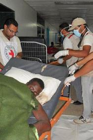 ICRC first-aid delegate Abdulbadih El Dada and Libyan Red Crescent staff move a body to the mortuary as the ICRC evacuates personnel and patients from the hospital.
