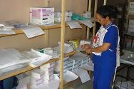 An ICRC worker verifies supplies of medicines at the ICRC-supported Gao regional hospital.