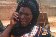 A woman gets an update on her son thanks to an ICRC phone.