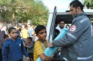 The ICRC and the Palestine Red Crescent Society distributing tarpaulins and plastic sheeting to cover up windows and doors that were damaged during the hostilities in November 2012.