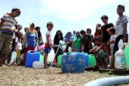 Joaquin Enriquez stadium, Zamboanga. Displaced persons collect drinking water.