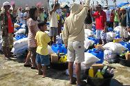 The ICRC and the PRC distribute food kits and basic household items to respond to the basic needs of the people in the areas hardest hit by typhoon Bopha.