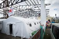 The fully equipped Red Cross tented hospital sees an average of 100 patients every day.