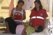 Annalyn Birong, who is seven months pregnant with her fifth child, seeks assistance from Red Cross medical staff at the basic health-care unit.