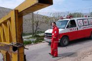 Palestinian Red Crescent ambulance blocked at Hebron barrier