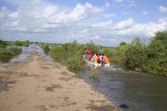Jowhar, Middle Shabelle region. The main road into Jowhar remains flooded, thus people and supplies are brought in by boat.