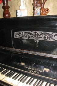 The old piano with the Tsibili maker's name has stood in Tina-deida's home since time immemorial. Even though she doesn't play, the 79-year-old grandmother would never part with it.