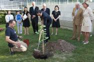 Deputy permanent representative of Japan in Geneva Takashi Okada helps plant the Gingko biloba tree.