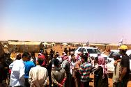 ICRC engineers speak to displaced people at a camp where the ICRC is working to improve water supply and sanitation.
