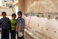 Displaced children from Deir Ezzor, Syria, in a school serving as a temporary home for them and their families.