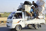 Raqqa province, eastern Syria. People flee the violence.