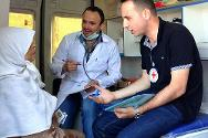 Tartous. A displaced woman seeks medical advice in an ICRC donated mobile health clinic.