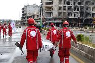 A pause in the fighting allows volunteers from the Syrian Arab Red Crescent to recover the bodies of those killed.