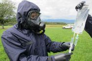 ICRC staff prepare to provide emergency health care in a simulated contaminated environment during an exercise.