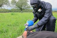A medic gives oxygen to a simulated victim of toxic chemicals during an ICRC exercise.