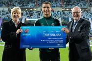 Cristiano Ronaldo of Real Madrid hands over a cheque for 100,000 euro to the ICRC in support of the organization's physical rehabilitation work in Afghanistan.