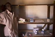 Central African Republic, 2012. An irregular and unreliable supply of medicines is the reason for the bare shelves behind this hospital pharmacist.