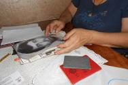 Mzevinar Popkhadze looks through souvenirs of Giorgi.