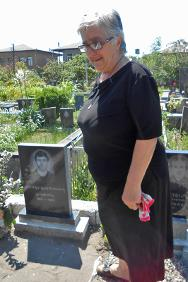 Mzevinar Popkhadze at the grave of her son Giorgi.