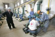 A team of technicians at work in Al Wethba pumping station, Baghdad, Iraq.