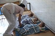 Nap-time. The ICRC donated food to the orphanage in late 2011 following flooding in the region.