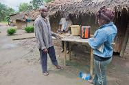 Liberian Red Cross hygiene officer Marie Freeman with Victor, a resident of Nikpachilu who has been trained to promote hygiene in his community.