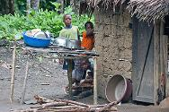 During our visit we noticed that there were small water containers next to each latrine, each house had a stand for kitchen utensils and families were using the communal latrines and baths instead of the forest.