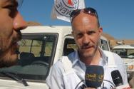 Cedric Schweizer, head of the ICRC delegation in Yemen, briefs journalists on the humanitarian situation in Dammaj and the ICRC's operations in the area, during a mission to evacuate casualties from Dammaj.