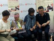 The Wong's family are sharing with each other the photos of Ting Lan's childhood. (From left to right) Wong Ting Lan, Ting Lan's mother, Ting Lan's eldest sister and younger brother