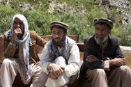 From left to right: Baba Jan, head of disaster management for the Afghan Red Crescent Panjshir branch, Qari Fazalhaq, and Mullah Mohammad in discussion with their visitors