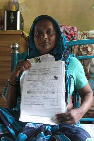 Mehera Begum, Babu's mother, holding the DNA sample paper.