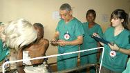 Bangui Community Hospital. Essam, an ICRC surgeon, treating one of the patients he has operated on.