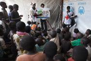 Displaced camp at Bangui airport, 18 February 2014. Volunteers with the Central African Red Cross in collaboration with ICRC speak to children during a day dedicated to raising awareness about hygiene in the camp.