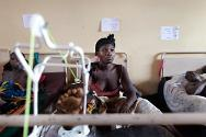 Bangui Community Hospital. 17 February 2014. A young woman in therapy to recover mobility after being wounded in a grenade explosion.
