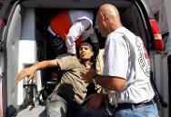 Shujaia, Gaza. ICRC staff transfer a casualty to an ambulance for evacuation.