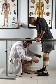 Artificial Limb and Polio Centre, Gaza. A man learns to walk again with an artificial leg.