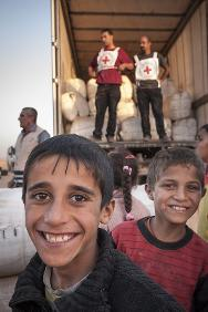 Bustana collection point. The ICRC distributes blankets and hygiene items to Syrian refugees.